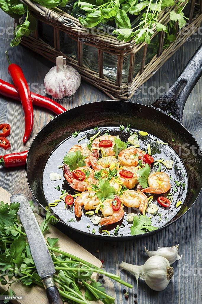 Shrimps served on a pan with herbs royalty-free stock photo