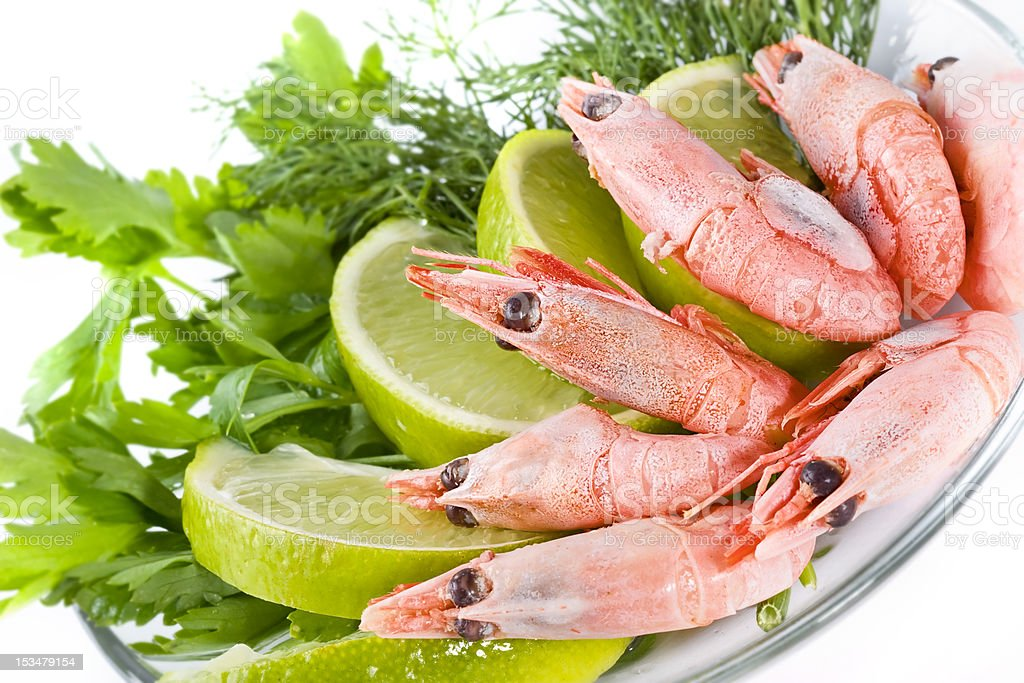 Shrimps served with lime royalty-free stock photo