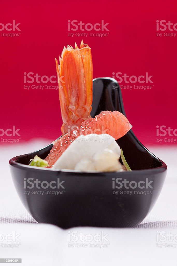 Shrimps with orange (red background) stock photo