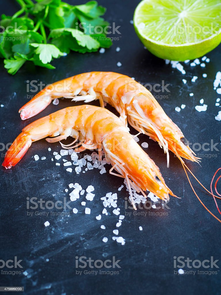 Shrimps with parsley and lime stock photo