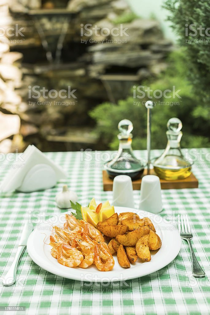 Shrimps with potatoes stock photo