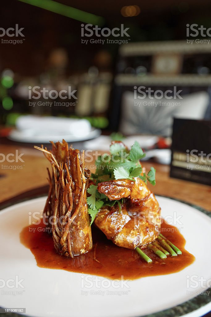 Shrimps with sweet-sour sauce on plate royalty-free stock photo