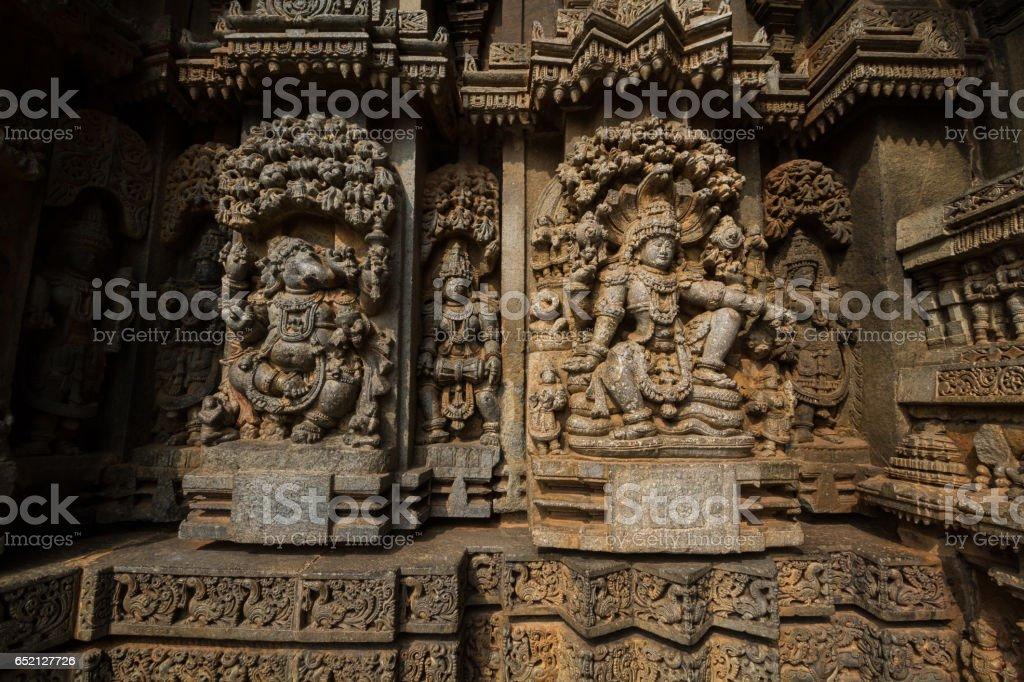 Shrine wall relief sculpture follows a stellate plan in the Chennakesava temple at Somanathapura,Varaha,India,Asia,Karnataka. stock photo