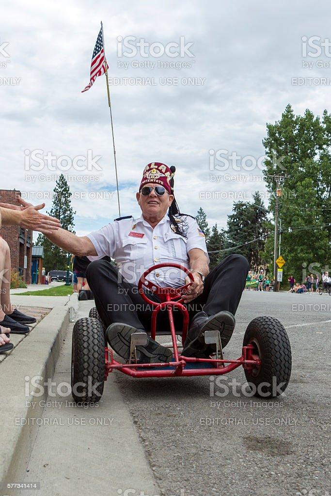 Shriner member drives go kart in parade. stock photo