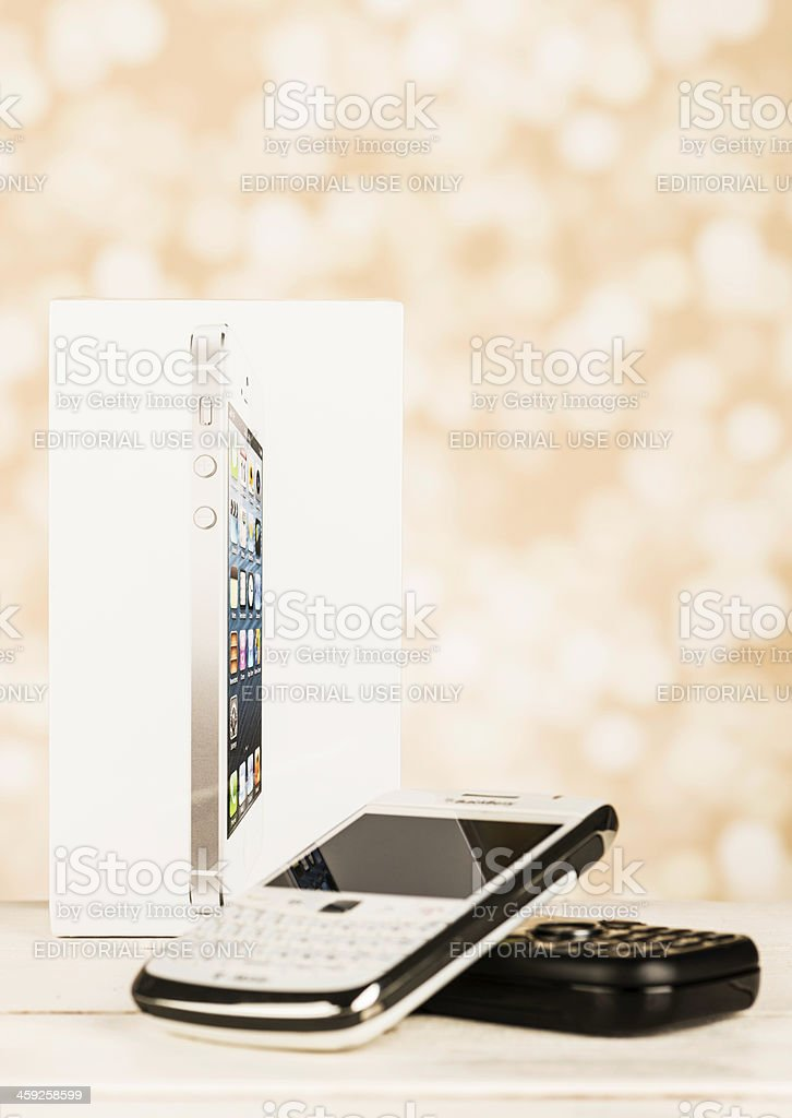 Shrink Wrapped New iPhone 5 with Older Used Phones stock photo