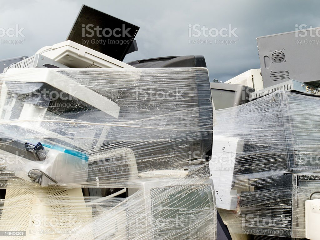 Shrink wrapped pile of electronics computer waste royalty-free stock photo