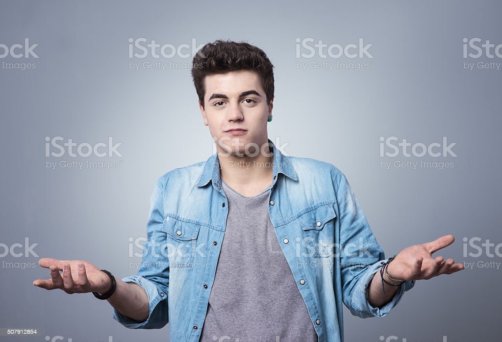 Shrugging guy with open palms stock photo