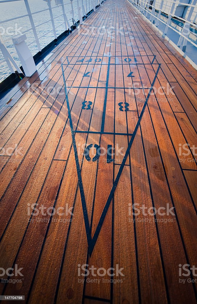 Shuffleboard on the deck of a cruise ship stock photo