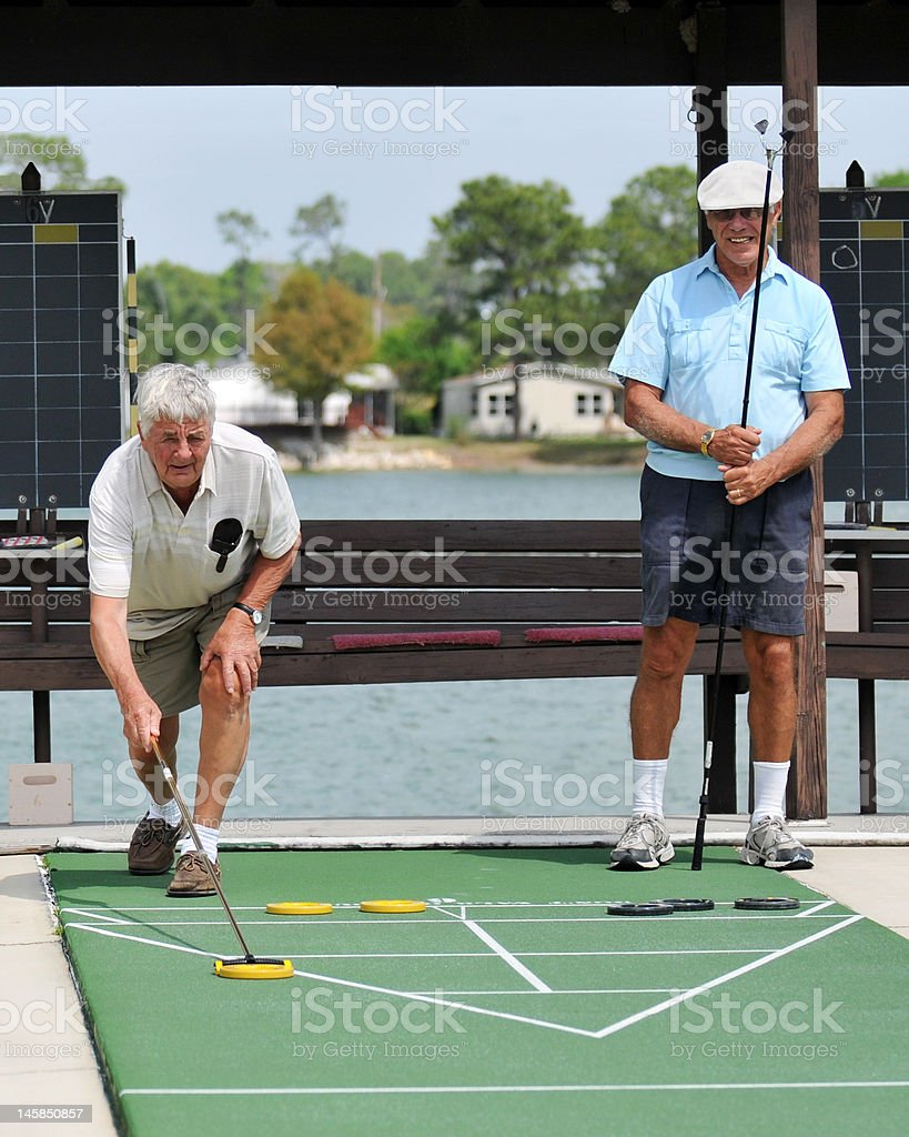 Shuffleboard Opponents stock photo