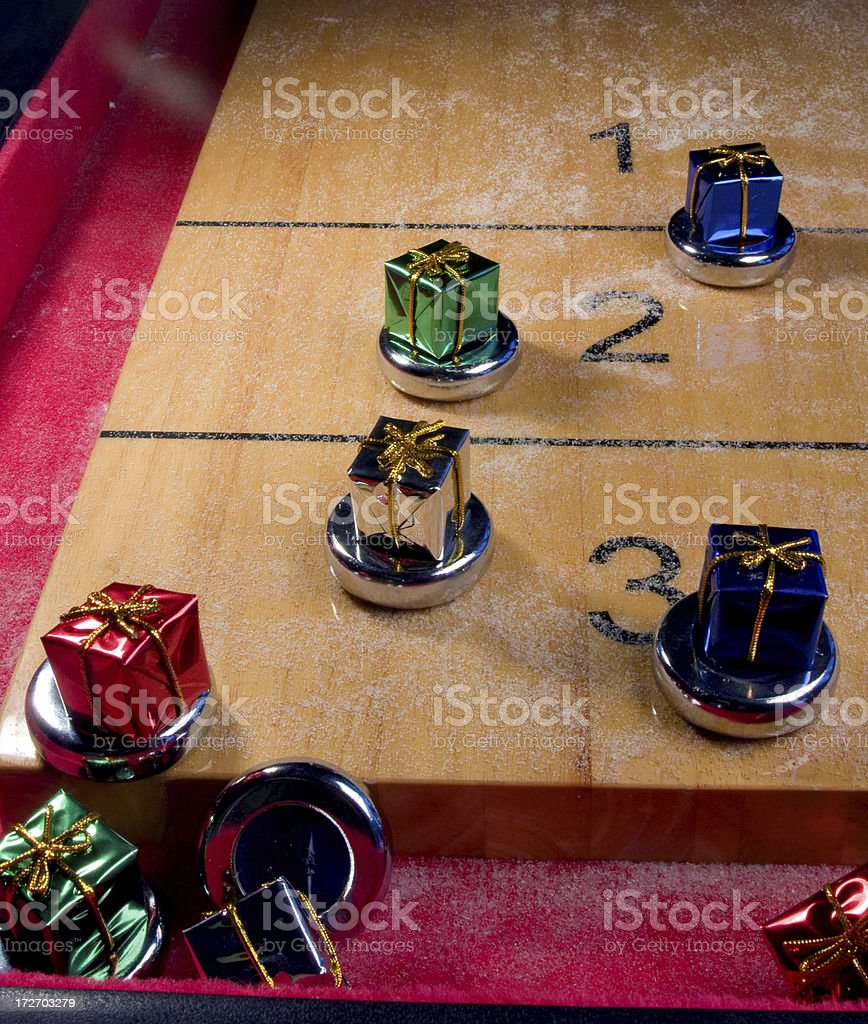 Shuffleboard Table End with Gifts stock photo