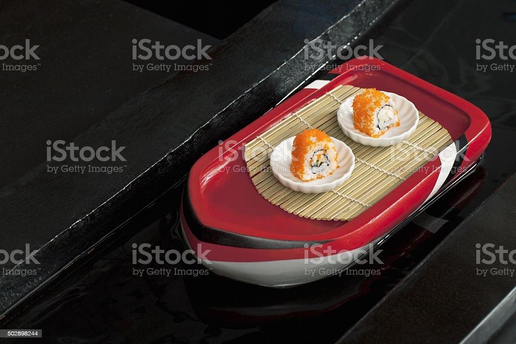 shushi rolls in white plate stock photo