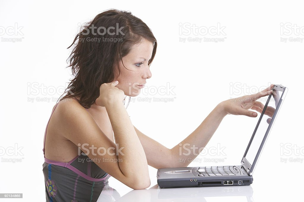 shutdown - woman touches screen of notebook for work royalty-free stock photo