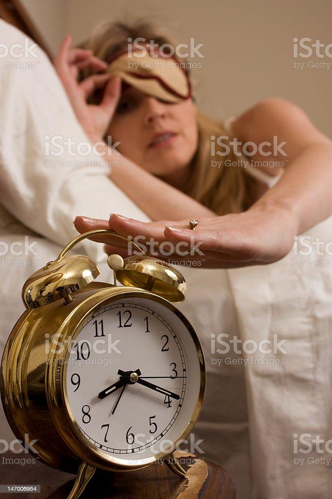 Shutting off the alarm clock royalty-free stock photo