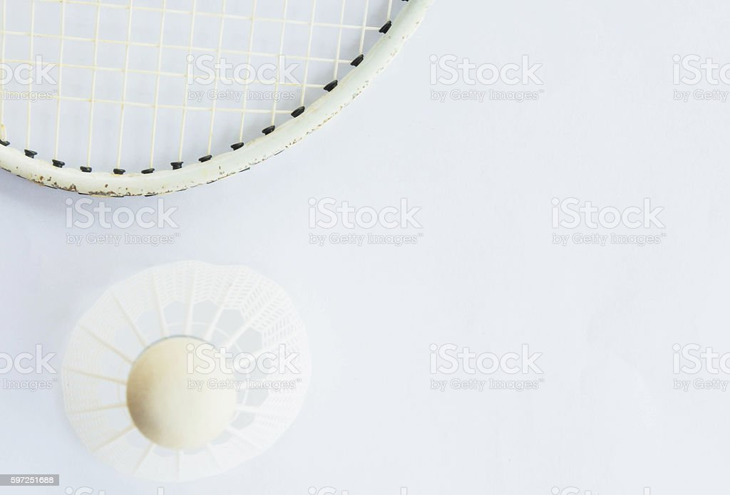 Shuttlecock and racket on white background stock photo