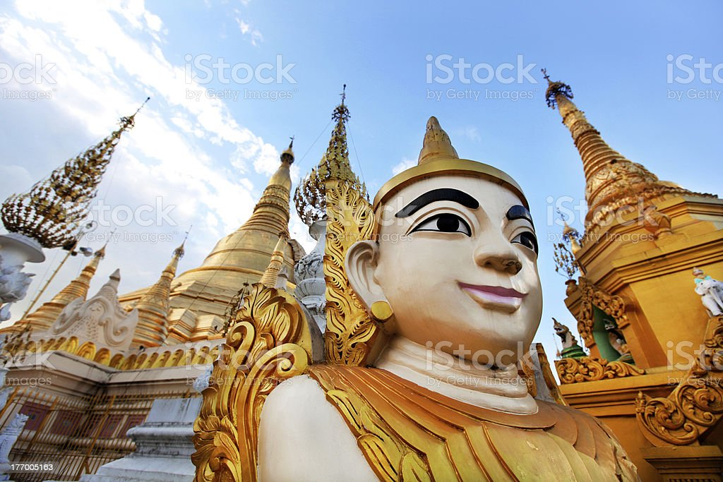 Shwedagon pagoda complex with buddha figure royalty-free stock photo