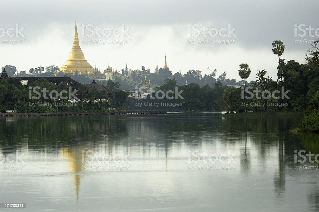 Shwedagon pagoda mirrored in lake stock photo