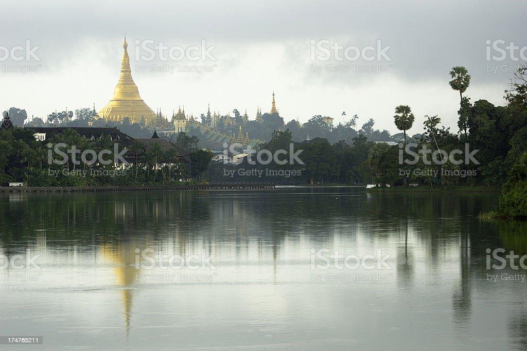 Shwedagon pagoda mirrored in lake stock photo