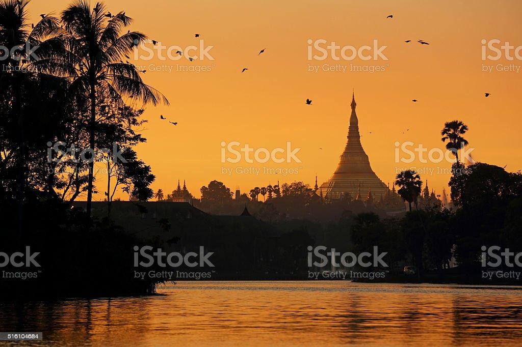 Shwedagon Pagoda over Kandawgyi Lake stock photo