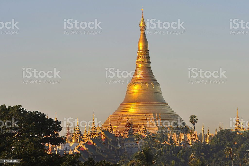 Shwedagon Pagoda Temple with village below in the morning light stock photo