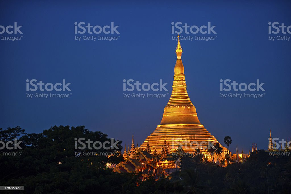 Shwedagon Pagoda Temple with village below in the twilight royalty-free stock photo