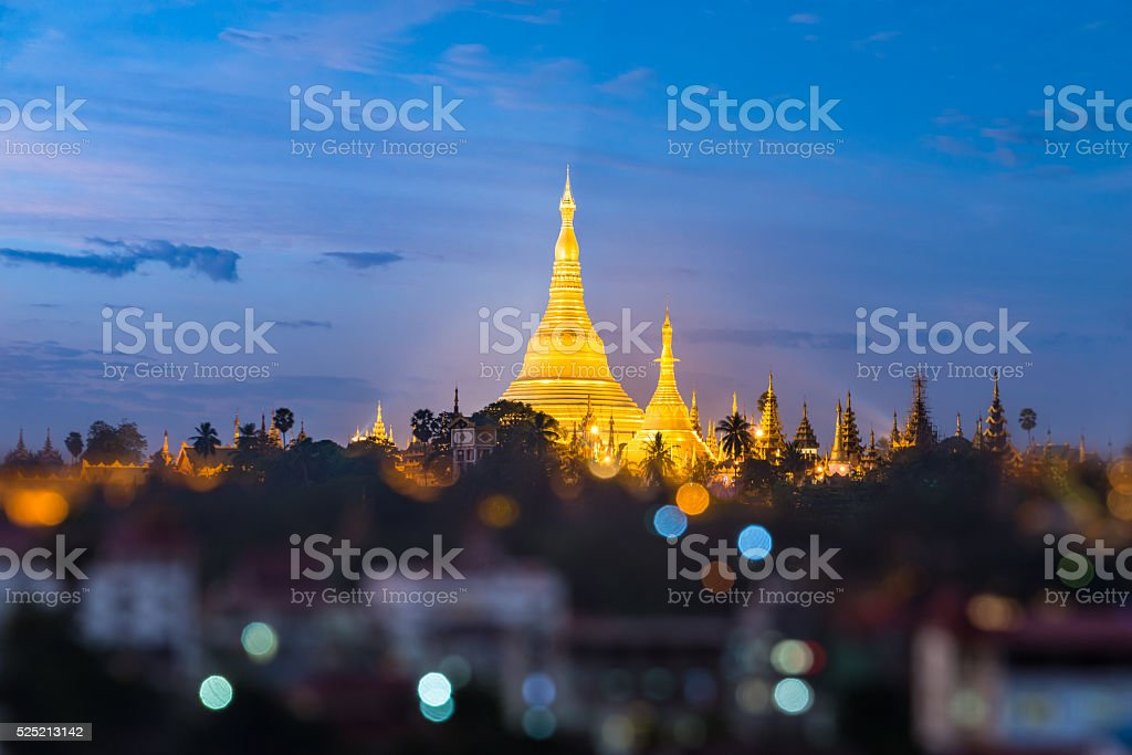 Shwedagon pagoda with bokeh foreground during twilight time stock photo