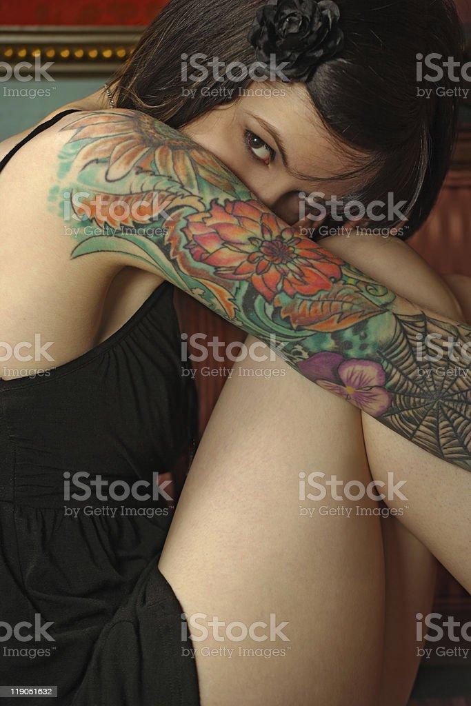 Shy female with tattoo stock photo