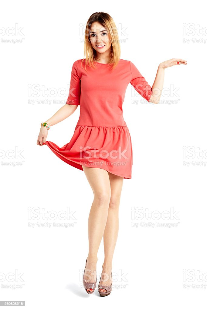 Shy girl shows her dress stock photo