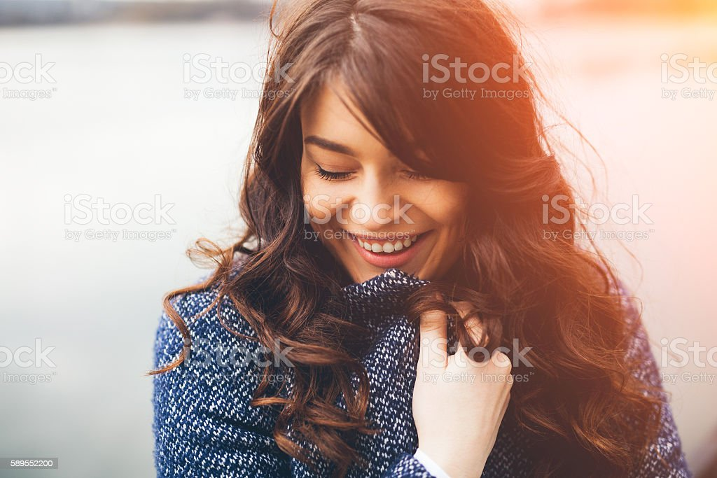 Shy girl standing looking down. stock photo