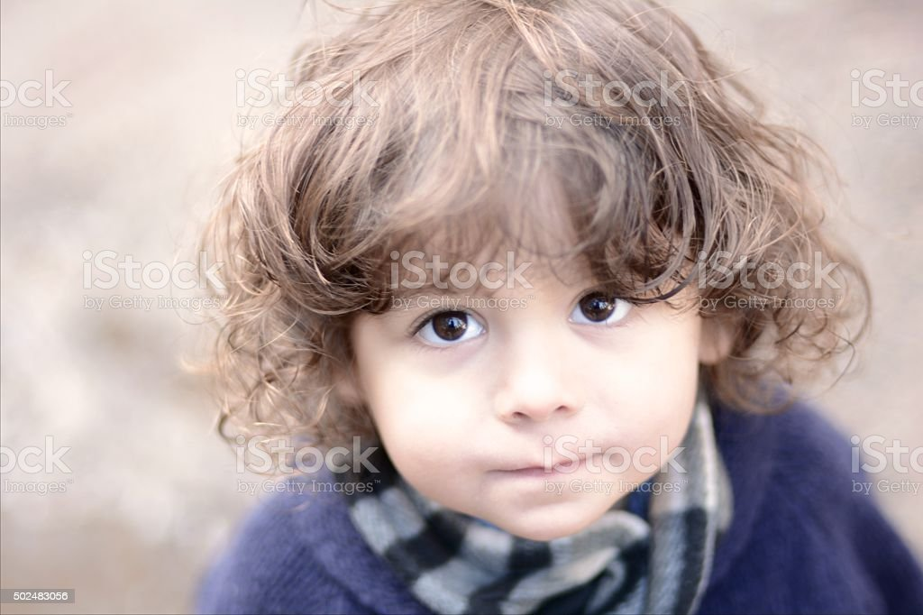 Shy little boy stock photo