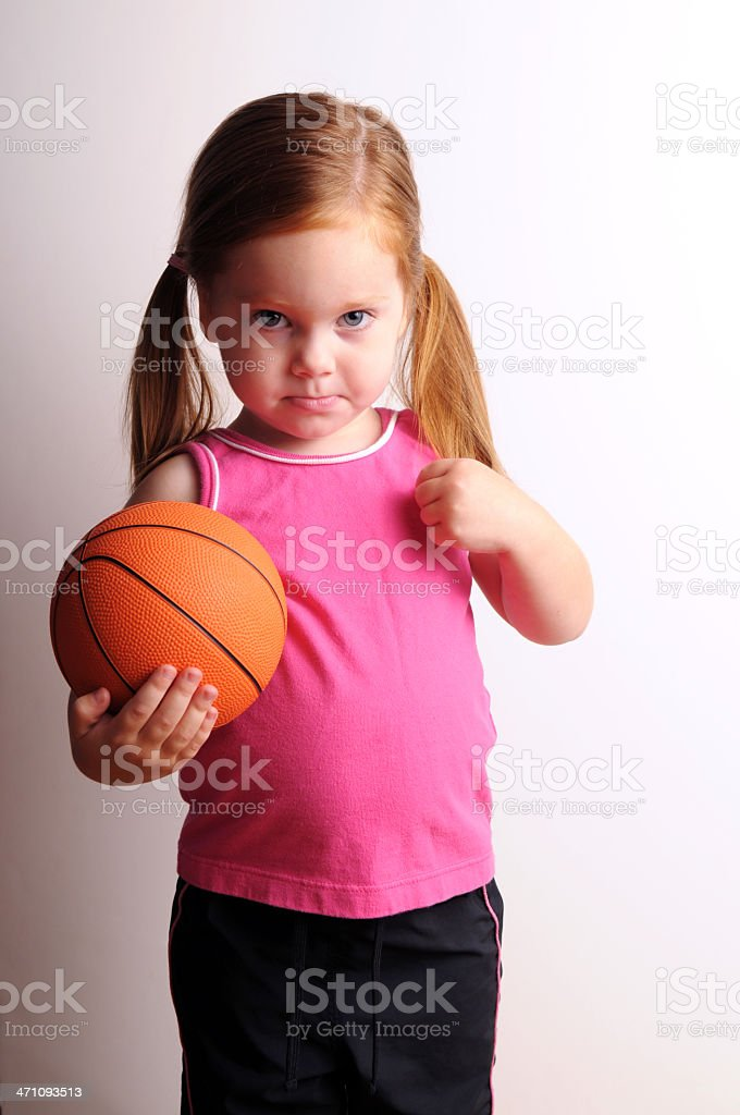 Shy Little Girl Holding a Basketball royalty-free stock photo