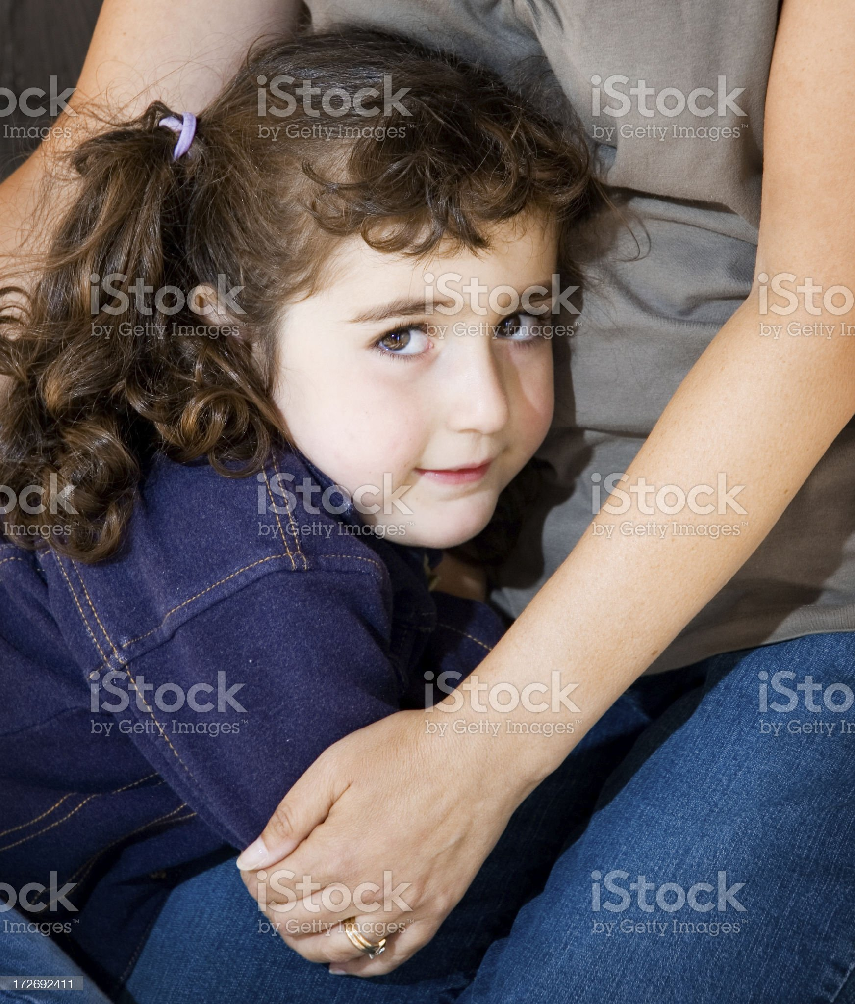 Shy Little Girl in Mother's Arms royalty-free stock photo