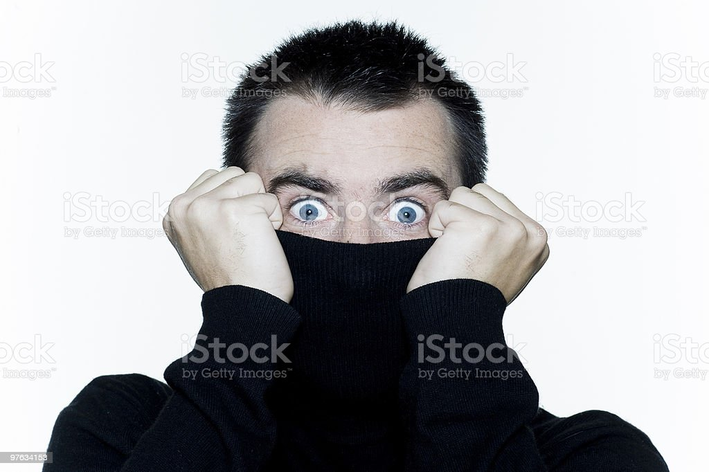 shy man surprised anonymous hiding behind his pull over royalty-free stock photo