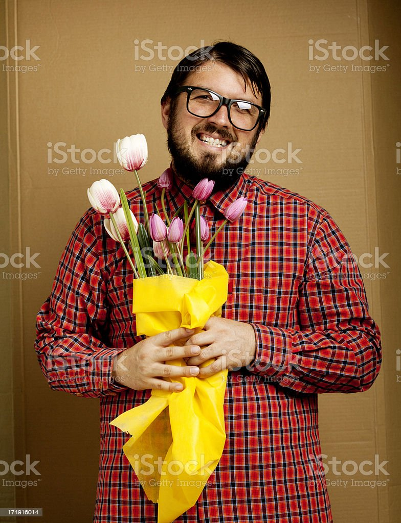 Shy nerd gay holding bunch of flowers royalty-free stock photo