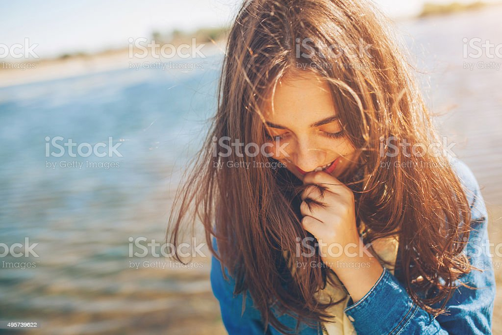 Shy teenage girl stock photo