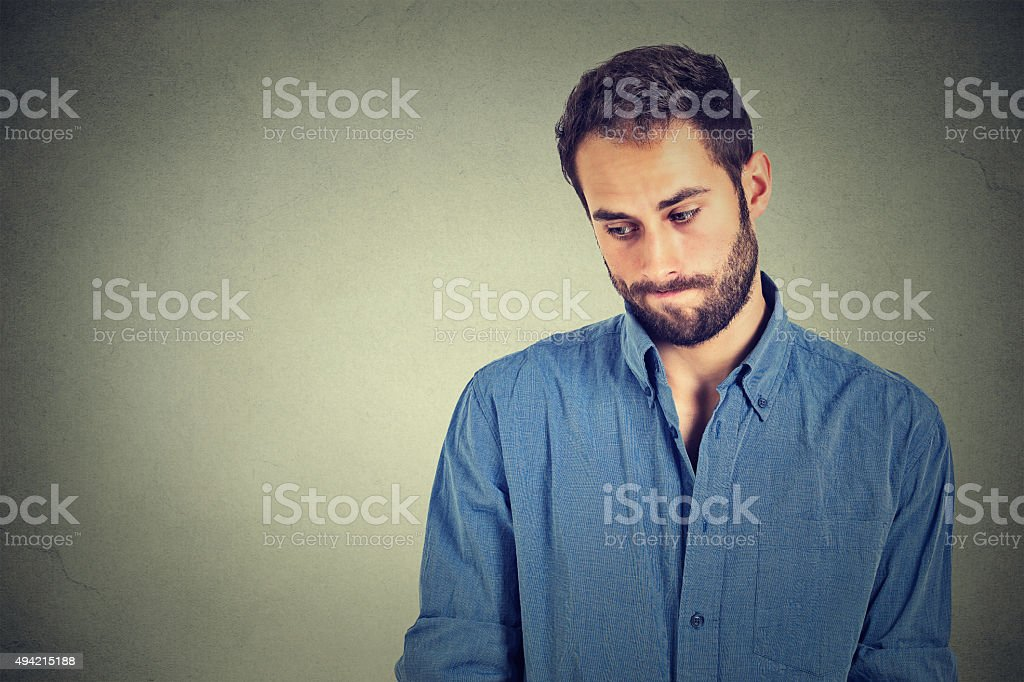 Shy young handsome man feels awkward stock photo