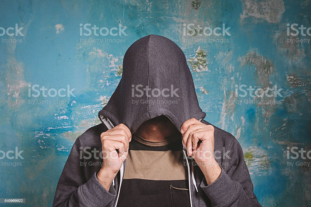 Shy young man closing his face stock photo