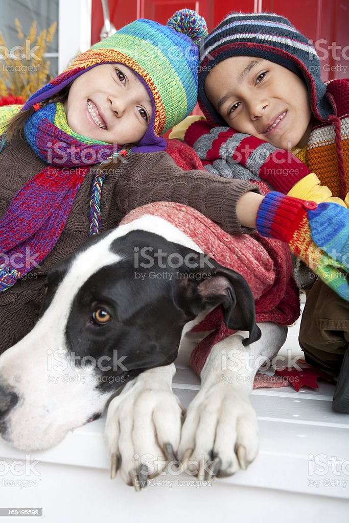 Sibling and their dog autumn portrait royalty-free stock photo