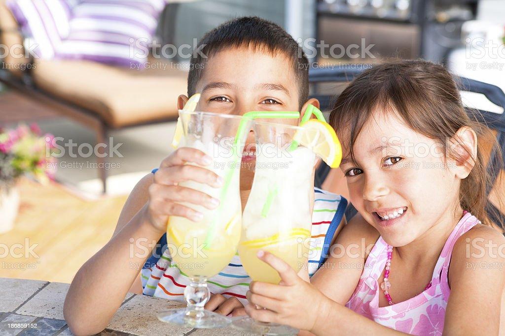 Sibling enjoying lemonade outdoor royalty-free stock photo