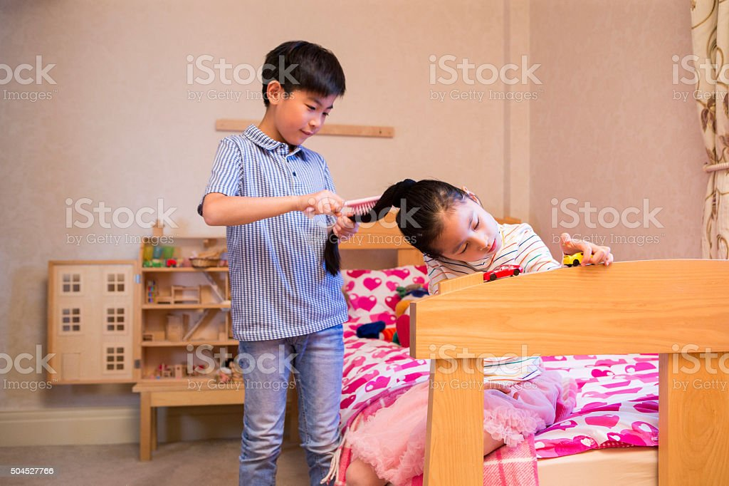 Sibling playing together stock photo