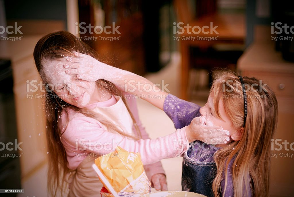 Sibling Rivalry -Food Fight - Children In The Kitchen Series stock photo