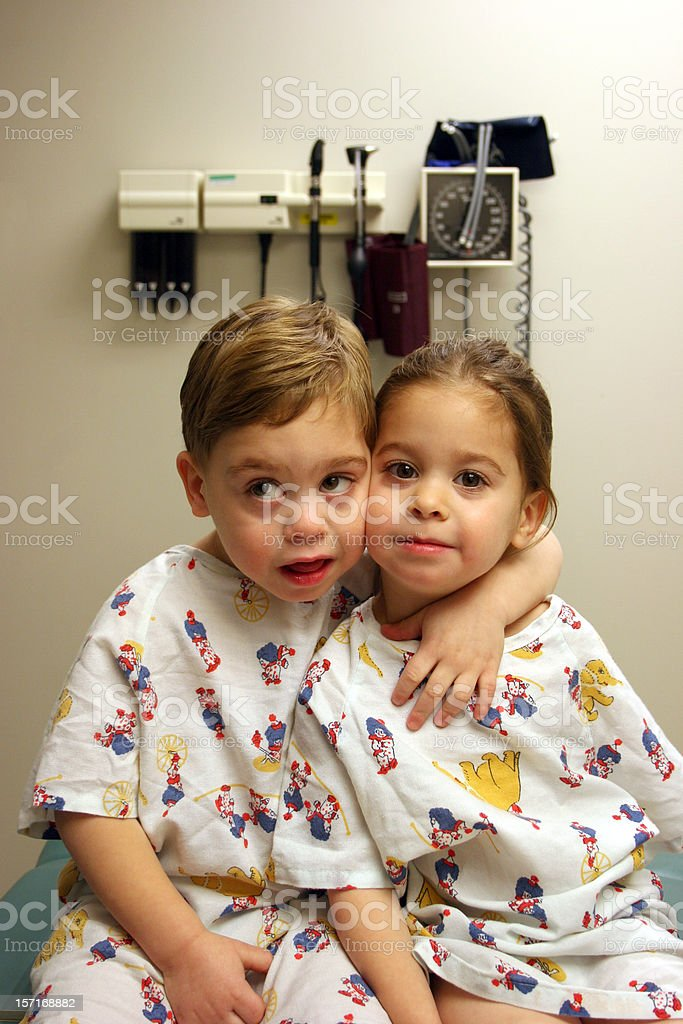 Siblings at the Doctor's Office Vertical royalty-free stock photo