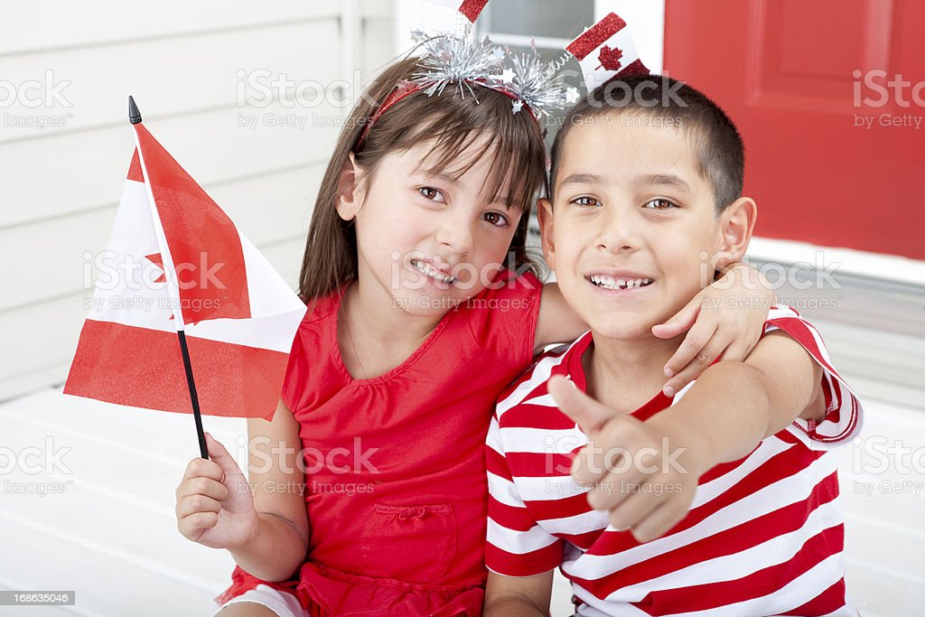Siblings celebrating Canada Day stock photo