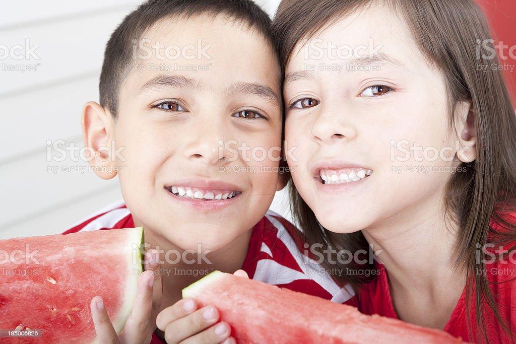 Siblings eating watermelon royalty-free stock photo