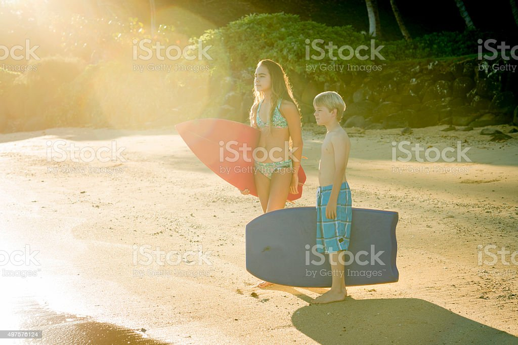 Siblings Going Surfing on Vacation stock photo