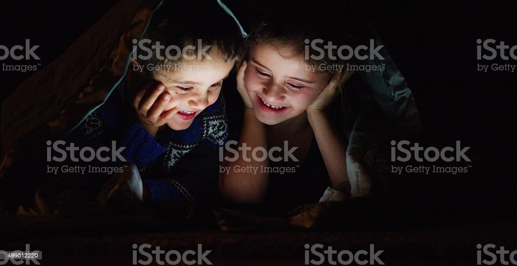 Siblings Having a Movie Night stock photo