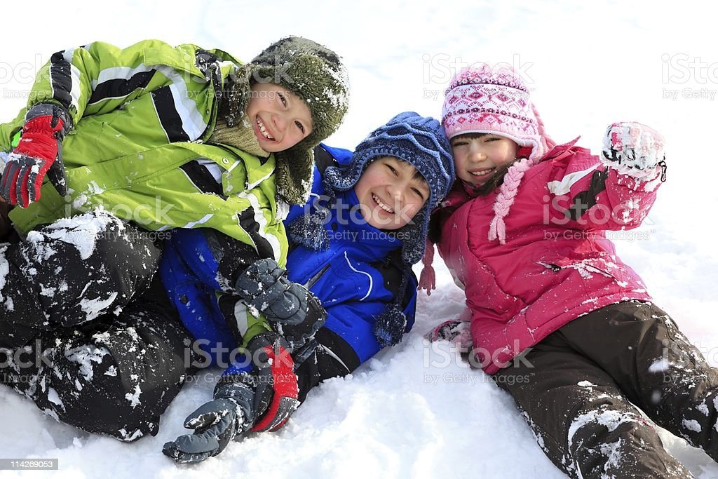 Siblings in the snow royalty-free stock photo
