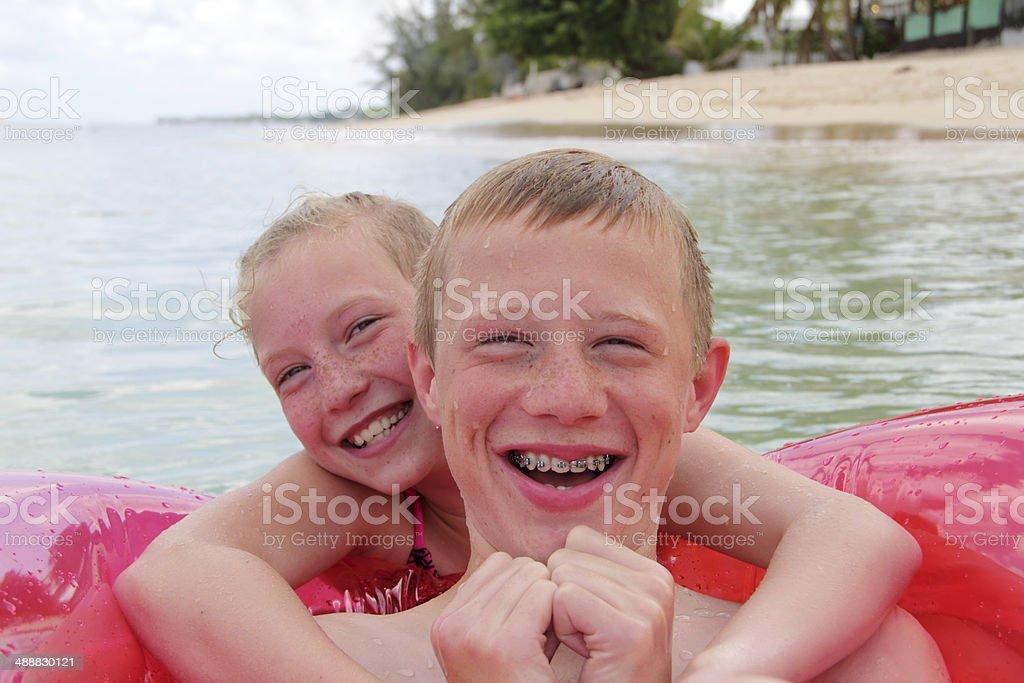 siblings laughing stock photo
