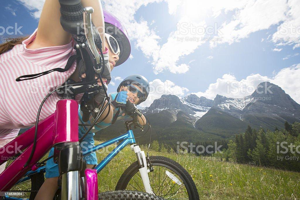 Siblings laying on their bike enjoying the view royalty-free stock photo