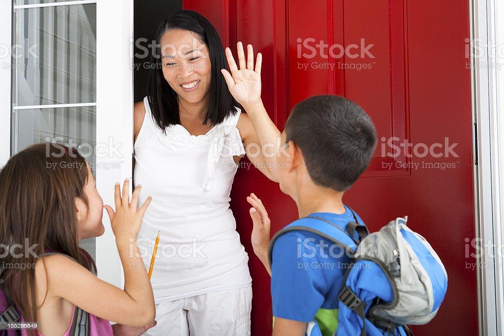 Siblings leaving for school stock photo