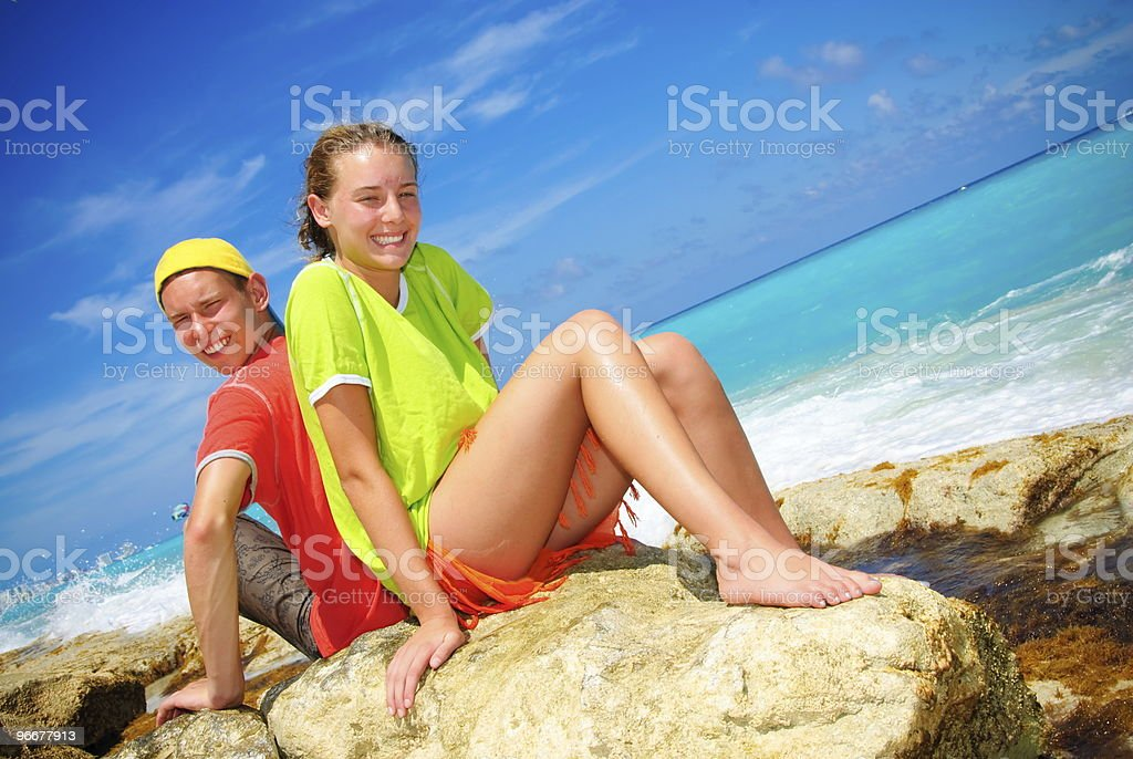 Siblings on the rock royalty-free stock photo